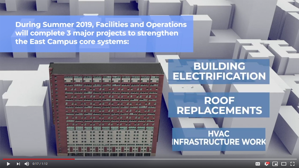 "Screenshot of a video showing the work that was performed at East Campus during Summer 2019, with text reading ""During Summer 2019, Facilities and Operations will complete 3 major projects to strengthen the East Campus core systems: building electrification, roof replacements, HVAC infrastructure work"""