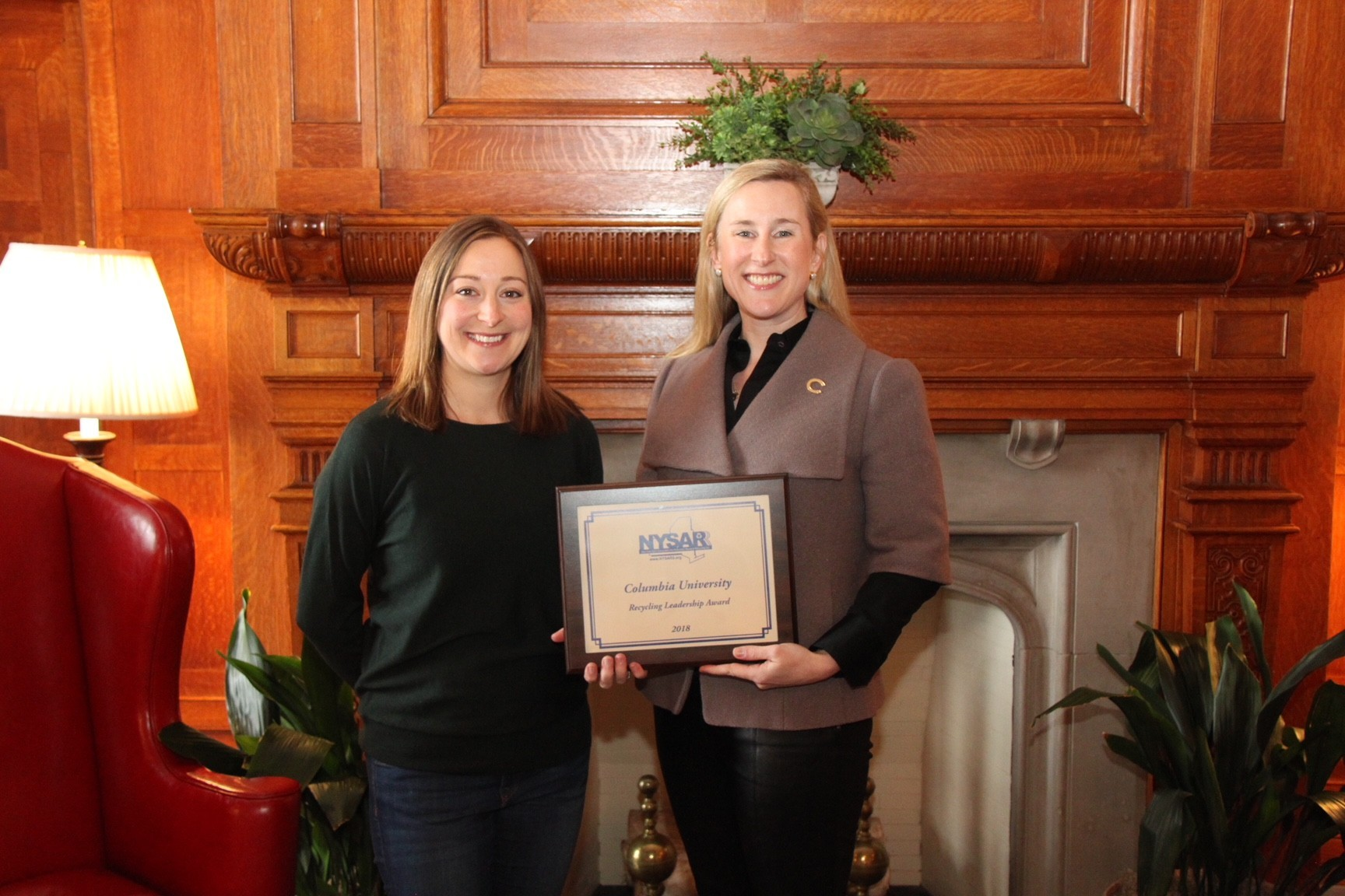Jessica Prata, assistant vice president of Environmental Stewardship for Columbia University, (right) is presented with the 2018 Recycling Leadership Award-College or University by NYSAR3 President Kelli Timbrook.