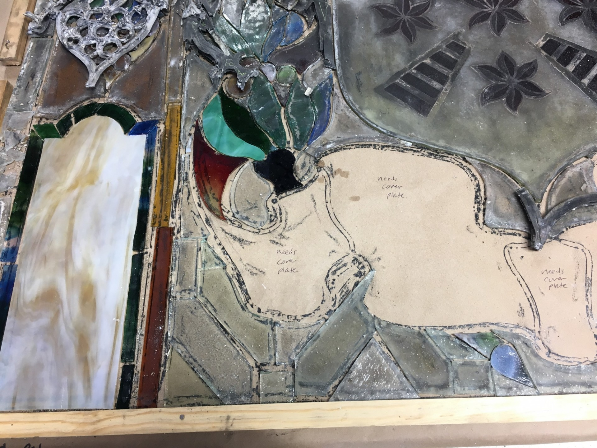 A portion of the stained glass windows being restored at a restoration studio